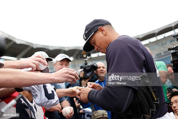 Third baseman Alex Rodriguez of the New York Yankees signs autographs for fans as he participates in a spring training workout on February 26 2015 at...