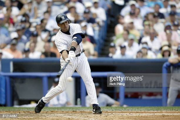Third Baseman Alex Rodriguez of the New York Yankees swings at a Toronto Blue Jays pitch during the game at Yankee Stadium on August 9 2004 in the...