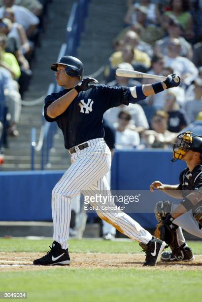 Third baseman Alex Rodriguez of the New York Yankees takes a swing against the Toronto Blue Jays during Spring Training March 6 2004 at Legends Field...