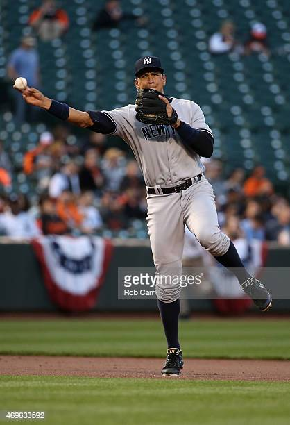 Third baseman Alex Rodriguez of the New York Yankees throws to first base between innings against the Baltimore Orioles in the first inning at Oriole...