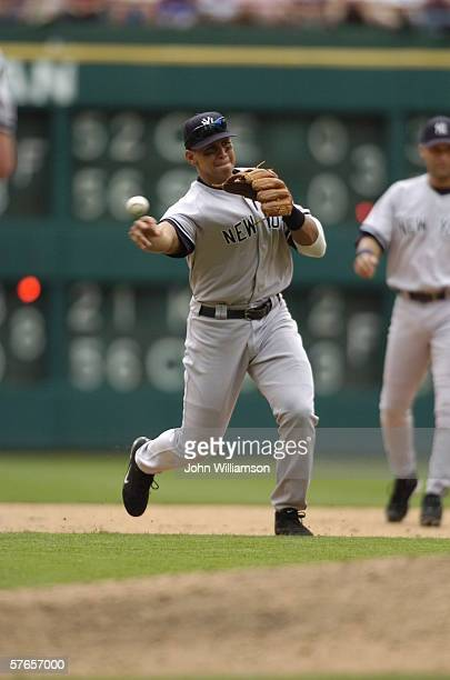 Third baseman Alex Rodriguez of the New York Yankees throws to first base after fielding a ground ball during the game against the Texas Rangers at...