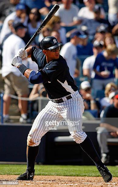 Third baseman Alex Rodriguez of the New York Yankees waits for a pitch against the Minnesota Twins during a Grapefruit League Spring Training Game at...