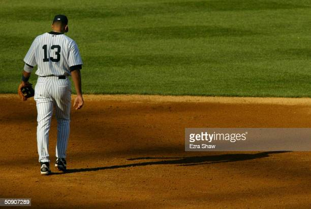 Third baseman Alex Rodriguez of the New York Yankees walks out to his position during the game against the Chicago White Sox on April 9 2004 at...