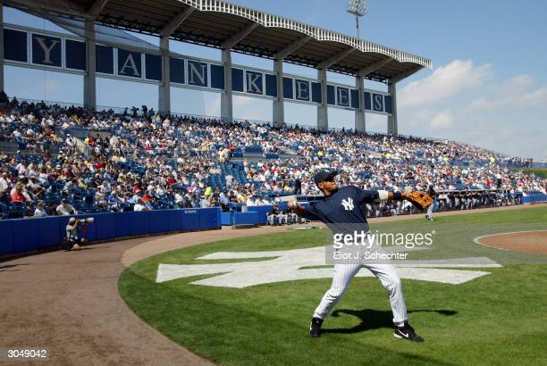 Third baseman Alex Rodriguez of the New York Yankees warms up before the start of their game against the Toronto Blue Jays during Spring Training...