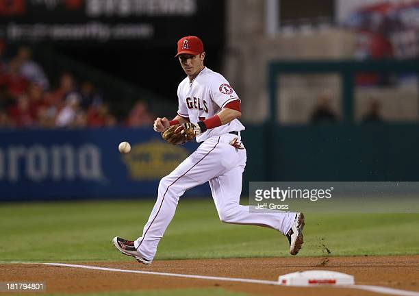Third baseman Andrew Romine of the Los Angeles Angels of Anaheim fields a ground ball against the Oakland Athletics at at Angel Stadium of Anaheim on...