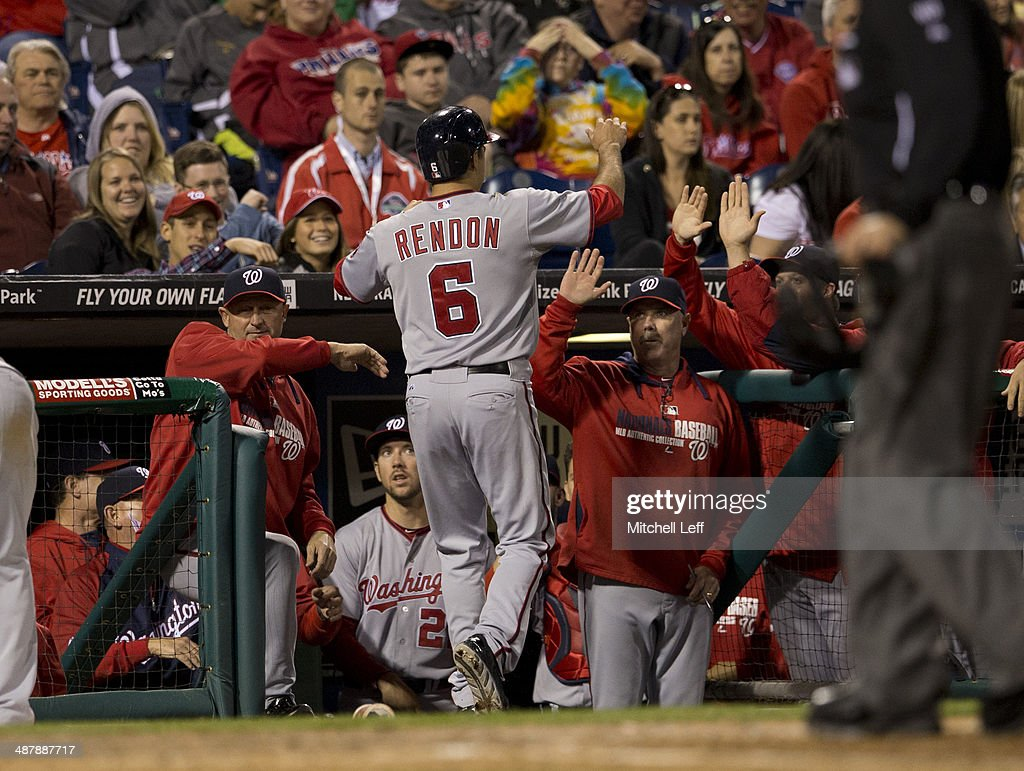 Third baseman Anthony Rendon #6 of the Washington Nationals scores the go ahead run and receives high fives from his teammates in the eighth inning against the Philadelphia Phillies on May 2, 2014 at Citizens Bank Park in Philadelphia, Pennsylvania.