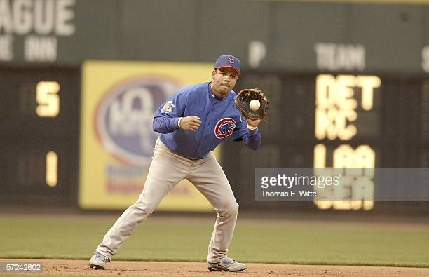 Third Baseman Aramis Ramirez of the Chicago Cubs grabs a ground ball while turning to first base against the Cincinnati Reds at Great American Ball...
