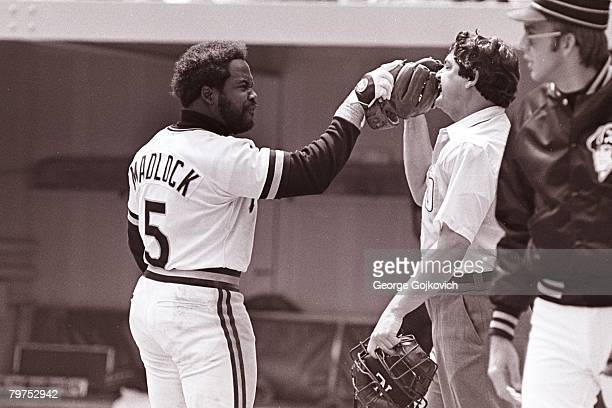 Third baseman Bill Madlock of the Pittsburgh Pirates confronts umpire Jerry Crawford after Crawford called him out on strikes to end an inning with...