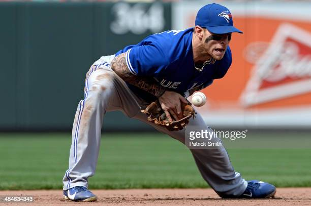 Third baseman Brett Lawrie of the Toronto Blue Jays makes a play in the seventh inning against the Baltimore Orioles at Oriole Park at Camden Yards...