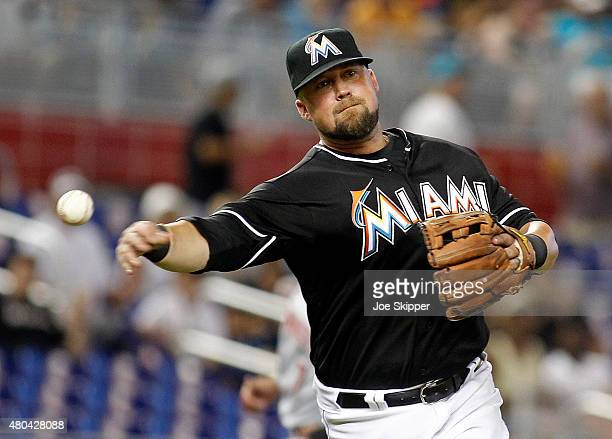Third baseman Casey McGehee of the Miami Marlins throws out baserunner Billy Hamilton of the Cincinnati Reds in the sixth inning at Marlins Park on...