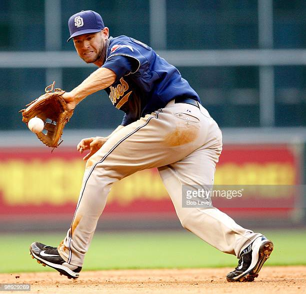 Third baseman Chase Headley of the San Diego Padres makes a backhand stab on a ball hit my Kazuo Matsui of the Houston Astros in the fifth inning at...