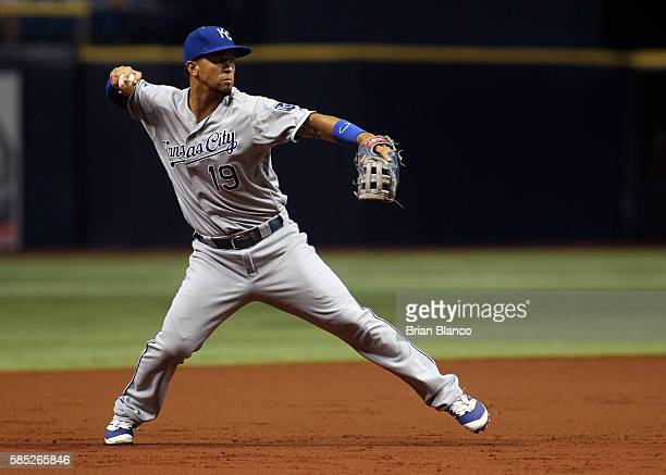 Third baseman Cheslor Cuthbert of the Kansas City Royals allows Evan Longoria of the Tampa Bay Rays to reach first base on a throwing error during...