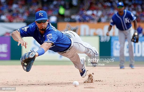 Third baseman Cheslor Cuthbert of the Kansas City Royals is unable to catch an RBI double hit by Hanser Alberto of the Texas Rangers during the...