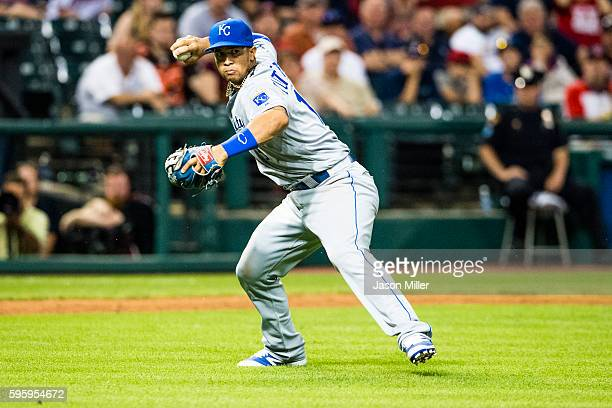Third baseman Cheslor Cuthbert of the Kansas City Royals throws out Jason Kipnis of the Cleveland Indians at first during the ninth inning at...