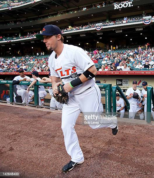 Third baseman Chris Johnson of the Houston Astros takes the field wearing the throwback Colt 45 uniforms against the Atlanta Braves at Minute Maid...