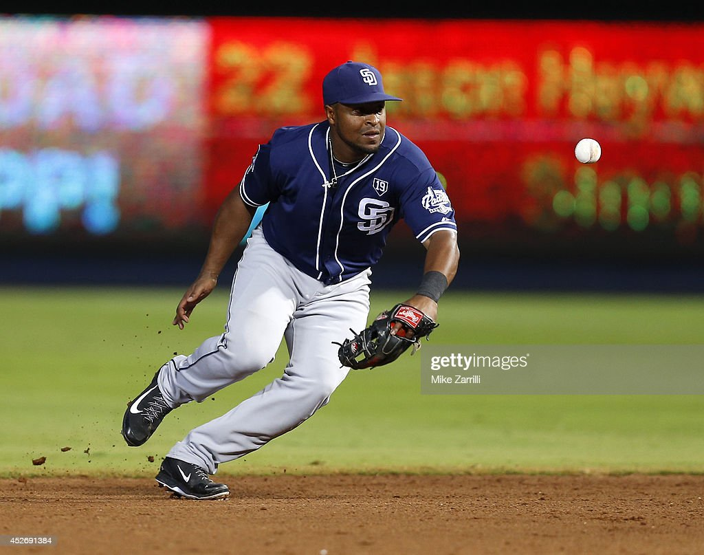Third baseman Chris Nelson #1 of the San Diego Padres makes a fielding error on a ball hit by right fielder Jason Heyward #22 of the Atlanta Braves (not pictured) during the fourth inning of the game against the at Turner Field on July 25, 2014 in Atlanta, Georgia.
