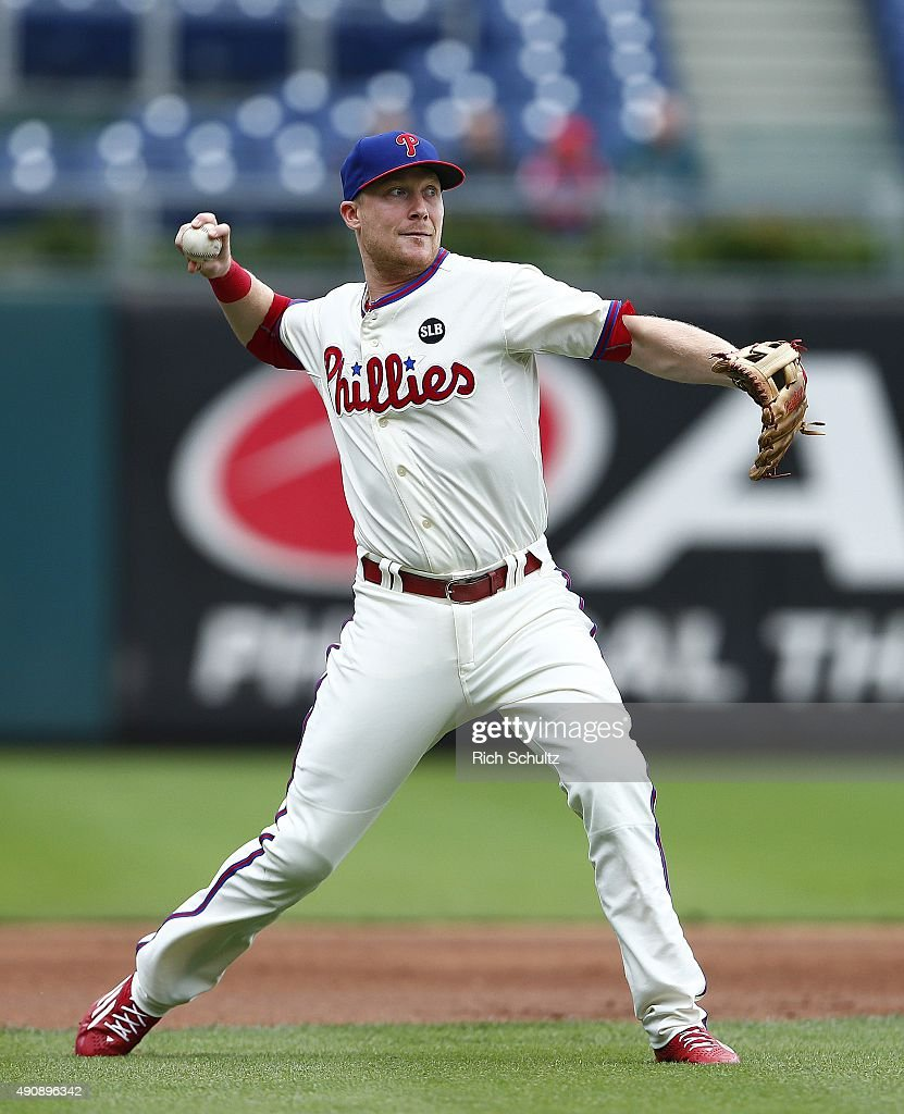 Third baseman Cody Asche #25 of the Philadelphia Phillies makes a throw to first base to get Ruben Tejada #11 the New York Mets during the first inning of a MLB game at Citizens Bank Park on October 1, 2015 in Philadelphia, Pennsylvania. The Phillies defeated the Mets 3-0.