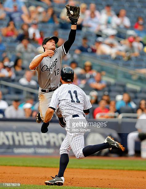 Third baseman Conor Gillaspie of the Chicago White Sox jumps high to catch a deflected ball hit by Derek Jeter of the New York Yankees who beat the...