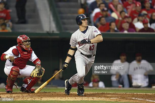 Third baseman Corey Koskie of the Minnesota Twins watches the ball in flight after contact during Game four of the American League Championship...