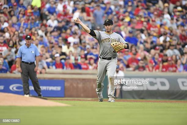 Third baseman David Freese of the Pittsburgh Pirates throws to first base after catching a ground ball in the game against the Texas Rangers at Globe...