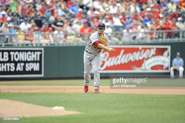 Third baseman David Freese of the St Louis Cardinals fields his position as he throws to first base after catching a ground ball during the game...
