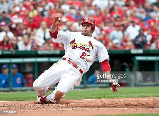 Third baseman David Freese of the St Louis Cardinals scores on an Edwin Jackson sacrifice fly to right against the Chicago Cubs on September 25 2011...