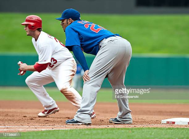Third baseman David Freese of the St Louis Cardinals takes off to second base on a hit and run play in the second inning against the Chicago Cubs on...