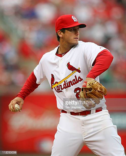 Third baseman David Freese of the St Louis Cardinals throws to first base in a game against the San Diego Padres at Busch Stadium on April 2 2011 in...
