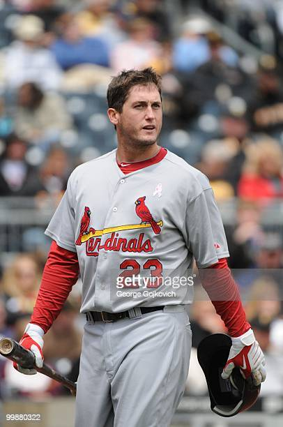Third baseman David Freese of the St Louis Cardinals walks back to the dugout after batting during a game against the Pittsburgh Pirates at PNC Park...