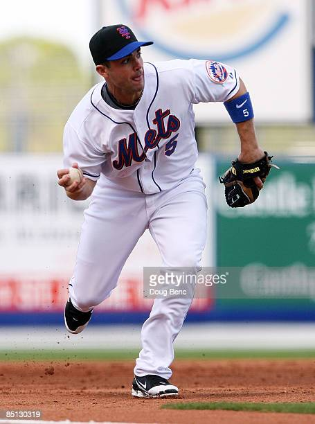 Third baseman David Wright of the New York Mets fields a ground ball against the Florida Marlins during a spring training game at Tradition Field on...