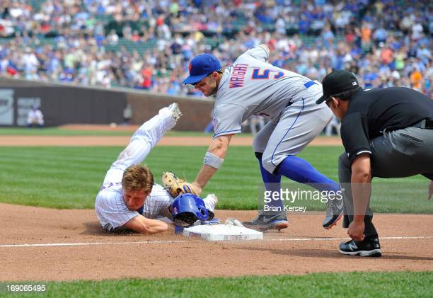 Third baseman David Wright of the New York Mets tags out Ryan Sweeney of the Chicago Cubs at third base as third base umpire Manny Gonzalez looks to...