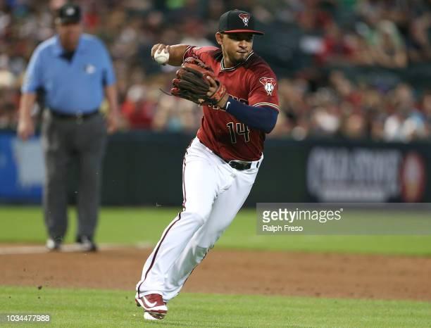 Third baseman Eduardo Escobar of the Arizona Diamondbacks looks to throw to first base on a ground ball against the Atlanta Braves during the second...