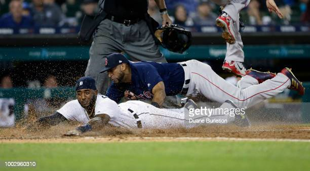 Third baseman Eduardo Nunez of the Boston Red Sox lands on Niko Goodrum of the Detroit Tigers after tagging Goodrum out during a rundown in the...