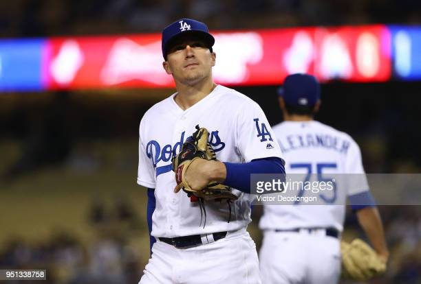 Third baseman Enrique Hernandez of the Los Angeles Dodgers looks on after making a throwing error to first base on a single to third by Starlin...