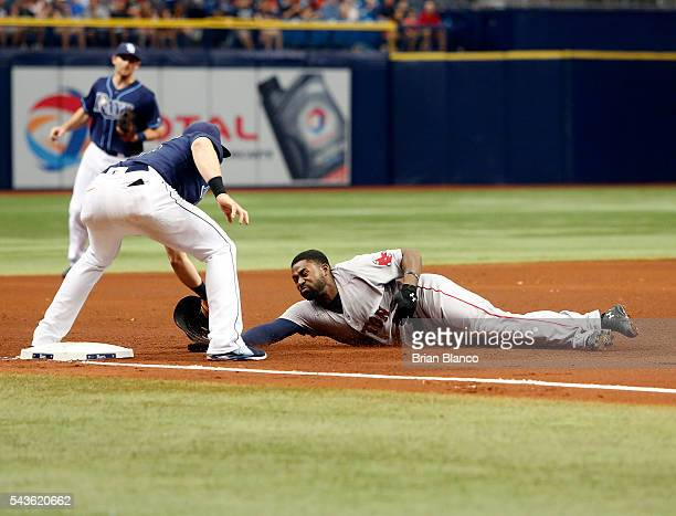 Third baseman Evan Longoria of the Tampa Bay Rays catches Jackie Bradley Jr #25 of the Boston Red Sox attempting to steal third base to end the top...