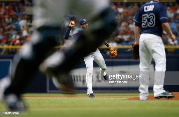 Third baseman Evan Longoria of the Tampa Bay Rays fields the single by Xander Bogaerts of the Boston Red Sox during the first inning of a game on...