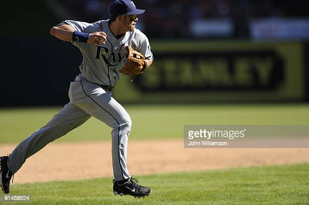 Third baseman Evan Longoria#3 of the Tampa Bay Rays fields his position as he throws to first base after fielding a slowly hit ground ball during the...