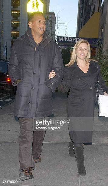 Third Baseman for the New York Yankees Alex Rodriguez and wife Cynthia Scurtis walk down the street after leaving Serafina November 30 2007 in New...