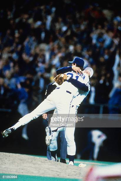 Third baseman George Brett lifts up pitcher Bret Saberhagen of the Kansas City Royals and the celebration starts after the final out of Game Seven...