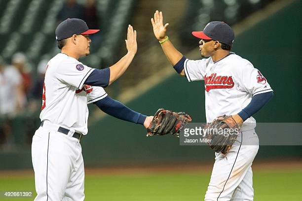 Third baseman Giovanny Urshela celebrates with shortstop Francisco Lindor of the Cleveland Indians after winning the game against the Kansas City...