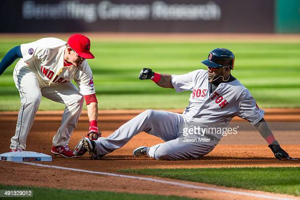 Third baseman Giovanny Urshela of the Cleveland Indians tags out David Ortiz of the Boston Red Sox on a steal attempt to end the top of the first...