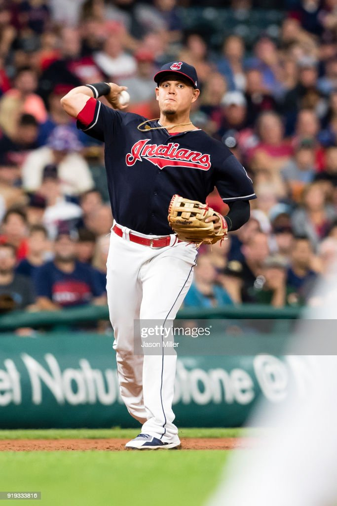 Third baseman Giovanny Urshela #39 of the Cleveland Indians throws out Mookie Betts #50 of the Boston Red Sox at first during the third inning at Progressive Field on August 22, 2017 in Cleveland, Ohio.