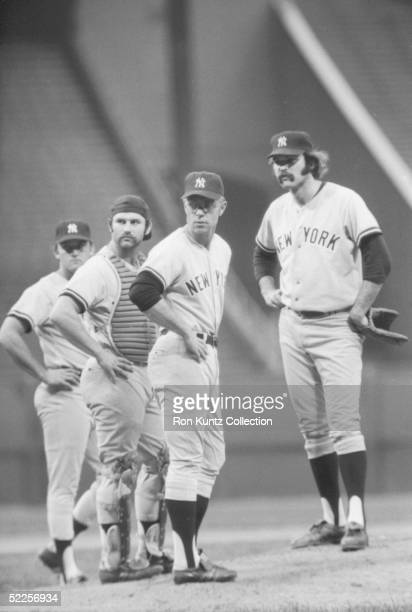 Third baseman Graig Nettles and catcher Thurman Munson join manager Bill Virdon and pitcher Dick Tidrow of the New York Yankees on the mound during a...