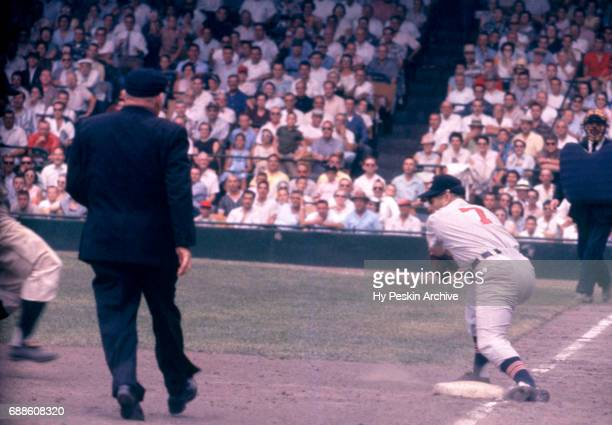 Third baseman Granny Hamner of the Cleveland Indians looks to put the tag down as umpire Bill Summers is there to make the call during an MLB game...