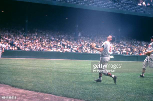 Third baseman Hal Smith of the Kansas City Athletics runs towards the outfield to try and make the catch during an MLB game against the Detroit...