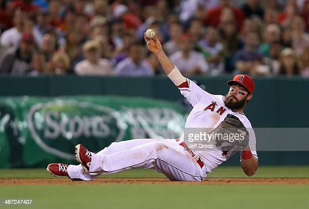 Third baseman Ian Stewart of the Los Angeles Angels of Anaheim isn't able to throw Carlos Santana of the Cleveland Indians out after making a diving...