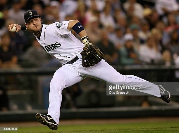 Third baseman Jack Hannahan of the Seattle Mariners fields a bunt base hit by Cliff Pennington of the Oakland Athletics on August 25, 2009 at Safeco...