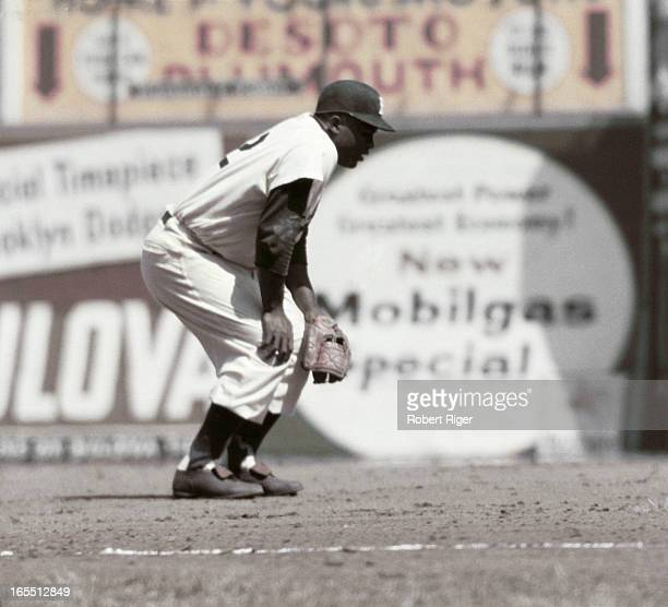 Third baseman Jackie Robinson of the Brooklyn Dodgers readies for the play during a game circa 1950's at Ebbets Field in Brooklyn New York