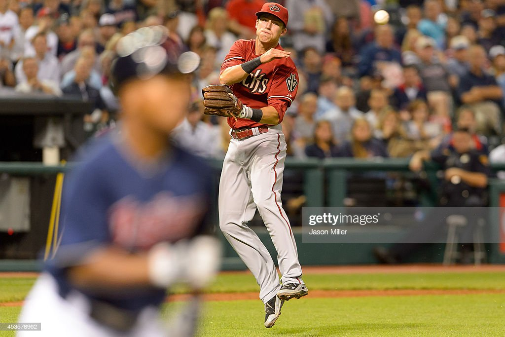 Third baseman Jake Lamb #19 of the Arizona Diamondbacks throws out Jose Ramirez #11 of the Cleveland Indians at first to end the seventh inning at Progressive Field during the second game of a double header on August 13, 2014 in Cleveland, Ohio.