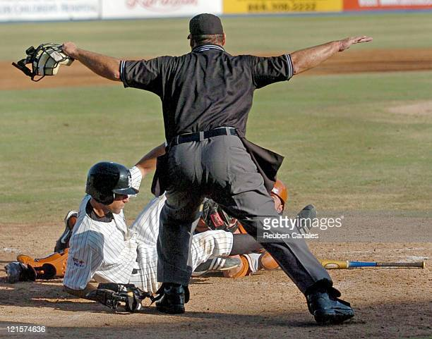 Third baseman Jason Tweedy of the Long Beach State Dirtbags slides into homebase to score a run in a 9 to 8 win over the University of Texas...